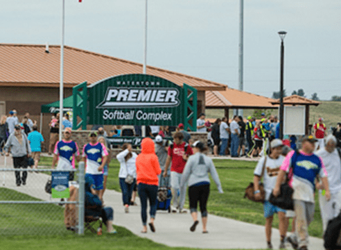 Premier Softball Complex entrance with people walking in