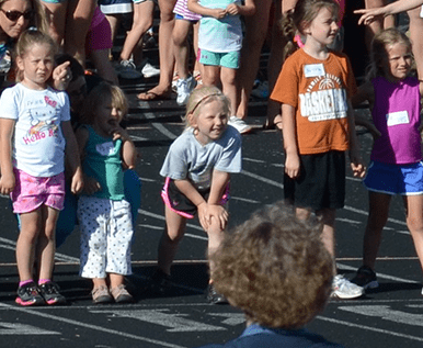 children at starting line of track meet