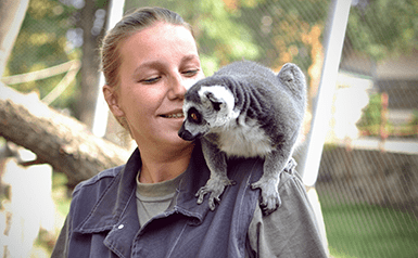 woman and lemur at Great Plains Zoo
