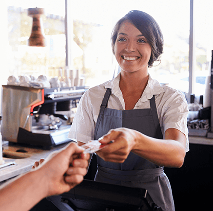 woman cashier accepting credit card for payment
