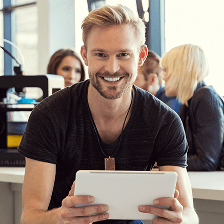 man using tablet smiling